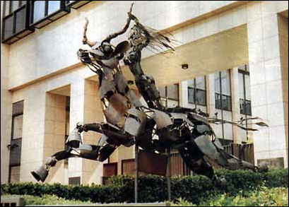 A woman riding a beast is displayed outside of the E.U. Parliament in Brussels!